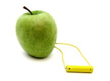 Green apple connected to a battery Stock Photo