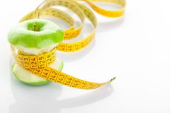 Green apple core and measuring tape Stock Photography