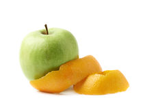 Green apple covered with orange peel Stock Images