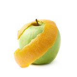 Green apple covered with orange peel Stock Photography