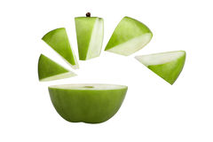 Green apple cut on pieces and slices. Stock Image
