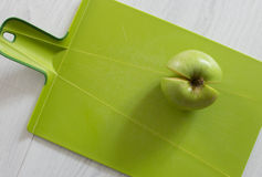 Green apple on a cutting board. And wood background Stock Photos