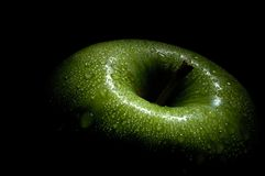 Green apple in the dark Royalty Free Stock Photos