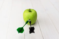 Green apple dart royalty free stock photo