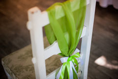 Green apple decor on wedding chair Stock Photos