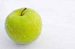 Green Apple. Delicious crisp green apple ready to be eaten stock image