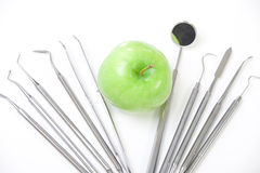 Green apple and dental tools Royalty Free Stock Photos