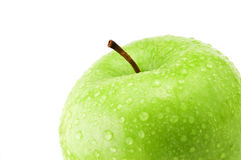 Green apple detail. Detail of healthy green apple with fresh water drops isolated on white background Stock Image