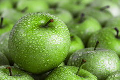 Green apple with dew drops Royalty Free Stock Photo