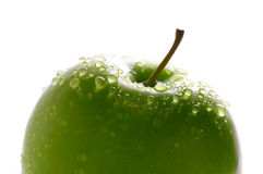 Green apple with dewdrops Royalty Free Stock Photos