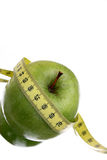 Green Apple Diet. Green apple and measuring tape; diet image Stock Photo