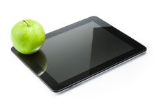 Green apple on digital tablet pc on white background Royalty Free Stock Photography