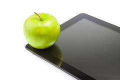 Green apple on digital tablet pc on white background with space for text Stock Images