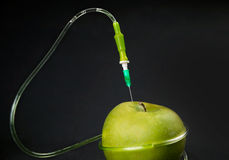 Green apple and drop counter Royalty Free Stock Photos