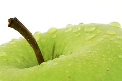 Green apple with droplets Royalty Free Stock Photos
