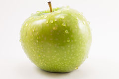 Green apple with drops stock images