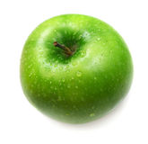 Green apple in drops of water Stock Photography