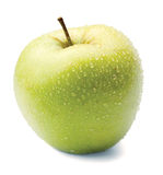 Green apple in drops on a white Stock Images