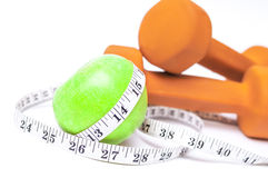 Green apple and a dumbbell Stock Image