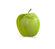 Green apple with earth Stock Photography