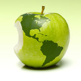 Green apple with earth map. Whole green apple with planet earth map applied (Americas Royalty Free Stock Photo