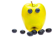 Green apple with eyes Royalty Free Stock Photos