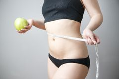 Green apple in female hands Royalty Free Stock Image