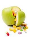 Green apple filled with drugs concept Royalty Free Stock Images