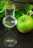 Green apple flavored grappa Royalty Free Stock Photos
