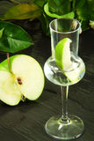 Green apple flavored grappa glass Stock Images