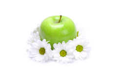 Green apple and flowers. On white background stock image