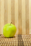 Green apple in front the wooden background Stock Photo