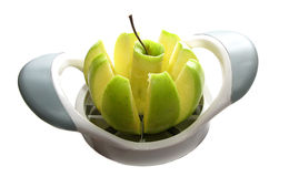 A green apple in a fruit-divider Stock Photos