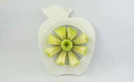 A green apple in a fruit-divider Royalty Free Stock Images