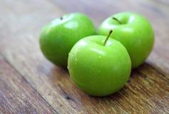 Green apple fruit on wood Stock Image