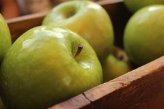 Green Apple Fruits on Brown Wooden Tray Royalty Free Stock Images