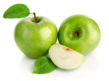 Green apple fruits with cut. Isolated on white background Royalty Free Stock Photo