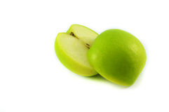 Green apple fruits with cut. Isolated on white in studio Stock Photos