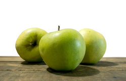Green apple fruits isolated on wooden white background. Close Royalty Free Stock Images