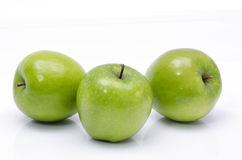 Green apple on a white background. Royalty Free Stock Photos