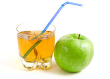Green apple and a glass of apple juice. Isolated on a white background Stock Image