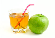 Green apple and a glass of apple juice. Ripe green apple and a glass of apple juice Isolated on white background Stock Image