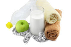 Green apple,glass of milk and measuring tape Stock Image