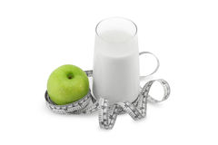 Green apple,glass of milk and measuring tape Royalty Free Stock Photography