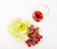 Green apple in a glass of wine Stock Image