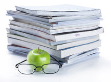 Green apple and glasses with magazine and  book stack Stock Photography