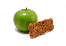 Green Apple and Granola Bar. Isolated on a white background Royalty Free Stock Photo