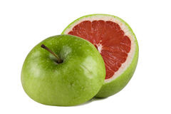 Green apple with grapefruit inside Stock Photography