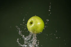 Green Apple on Green Background Stock Images