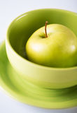 Green apple in green bowl Stock Photography